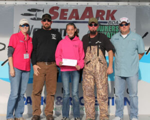 Brooke Mayfield was much younger, and understandably proud the first time she and her Dad collected a check in a SeaArk catfishing tournament on Wheeler Lake, one of her favorite lakes. (Contributed Photo)