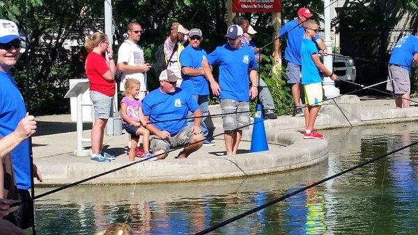 Thirteen members of ICCA volunteered to help the kids at the Indiana State Fair Fishin' Pond.