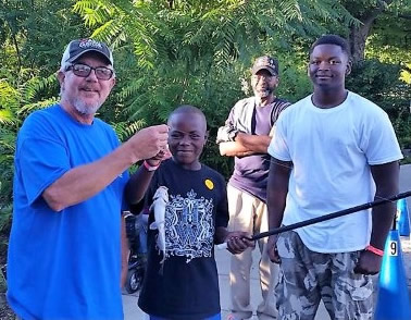 The kids were helped with baiting hooks and catching fish. The payoff was in smiles.