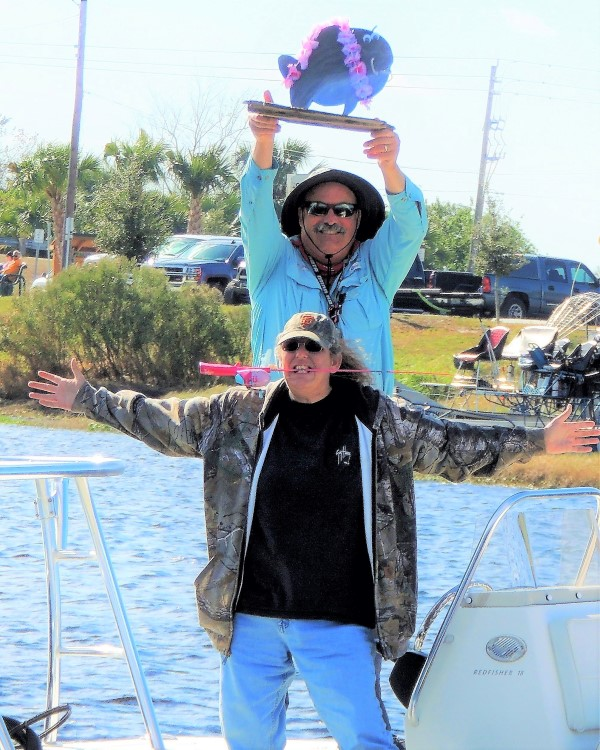 Tammy and her fishing partner, Tom Van Horn, celebrate a win in the toy rod catfish tournament that they formed in conjunction with Ron Suttles.