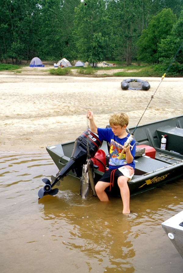 A child with his own fishing pole is a happy child. No need for expensive tackle. A cane pole or kid's fishing combo will work just fine. (Keith Sutton Photo)
