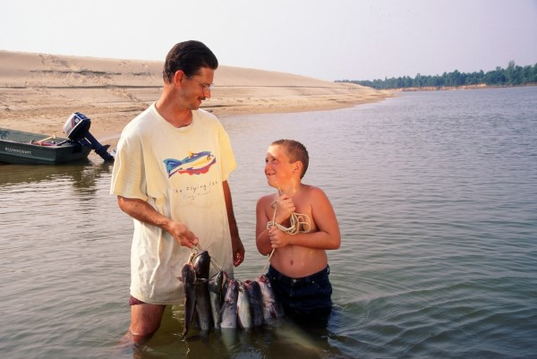 A youngster enjoying a fun fishing trip with an older relative or family friend creates everlasting memories. (Keith Sutton Photo)