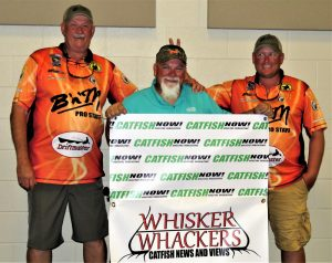 There is never a dull moment when Godwin is in the house. He is shown here with fishing partners Roy Harkness and Don Sweat.